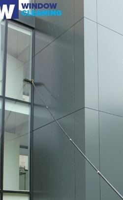 commercial building windows cleaned with water fed pole